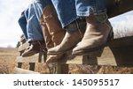 Cowboys And Cowgirls Sitting O...