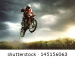 A Picture Of A Biker Making A...