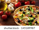 fresh homemade veggie pizza... | Shutterstock . vector #145189987