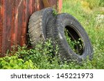Two Old Tires With Green Grass