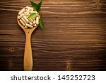 vitamin capsules in a wooden... | Shutterstock . vector #145252723