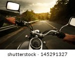 Driver Riding Motorcycle On An...