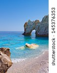 Small photo of Lalaria beach and the famous holey rock at Skiathos island in Greece