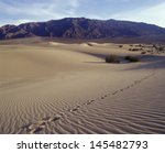 single track of footsteps in  ... | Shutterstock . vector #145482793