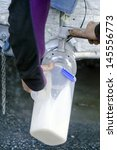 Small photo of PERIA, NZ - JULY 07:Jar of fresh milk from a milking facility on July 07 2013.The income from dairy farming is now a major part of the New Zealand economy, becoming an NZ$11 billion industry by 2010.