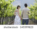 happy young couple holding... | Shutterstock . vector #145599823