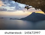 Young Female Rock Climber At...