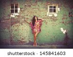 Woman In Colorful Summer Dress...