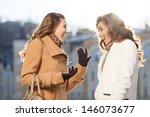 Girls Gossiping. Two Beautiful...
