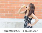 asian woman eat chicken burger | Shutterstock . vector #146081207