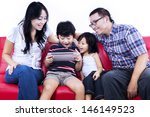 excited family playing game...   Shutterstock . vector #146149523