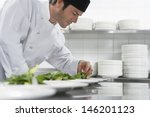 Side View Of A Male Chef...