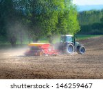 tractor seeding grains in early ... | Shutterstock . vector #146259467