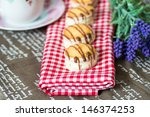 chocolate biscuit on red napkin  | Shutterstock . vector #146374253