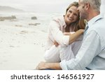 happy loving couple sitting on... | Shutterstock . vector #146561927