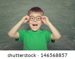 cheerful smiling boy on a green ... | Shutterstock . vector #146568857