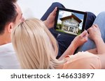 couple looking at house on... | Shutterstock . vector #146633897