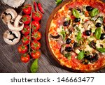 italian pizza served on wood | Shutterstock . vector #146663477
