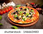 italian pizza served on wood   Shutterstock . vector #146663483