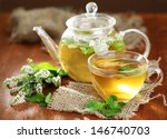 Cup And Teapot Of Herbal Tea...