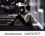 girl sitting on a street at... | Shutterstock . vector #146767577
