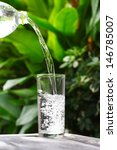 glass of water on nature... | Shutterstock . vector #146785007