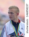 Small photo of DONETSK, UKRAINE - JULY 14: Bronze medalist in 800 metres Kyle Langford of Great Britain on medal ceremony during 8th IAAF World Youth Championships in Donetsk, Ukraine on July 14, 2013