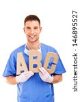young doctor holding letters a... | Shutterstock . vector #146895527