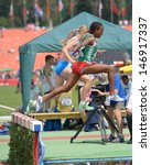 Small photo of DONETSK, UKRAINE - JULY 12: Weynshet Ansa of Ethiopia (in front) and Nicole Reina of Italy compete in 2000 m steeplechase during 8th IAAF World Youth Championships in Donetsk, Ukraine on July 12, 2013