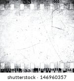 scratched filmstrip texture | Shutterstock . vector #146960357