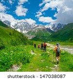 young hikers trekking in... | Shutterstock . vector #147038087