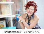 young beautiful woman sitting... | Shutterstock . vector #147048773