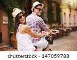 Happy Couple Riding A Bicycle...