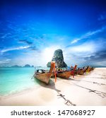 Travel to Thailand exotic destination landscape. Paradise island beach with boats. Beauty of thai tourism