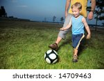 boy playing football with his... | Shutterstock . vector #14709463