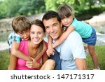family relaxing by river in...   Shutterstock . vector #147171317