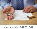 real estate agent handing over... | Shutterstock . vector #147231047