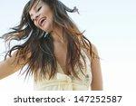 Joyful Young Woman Flicking He...