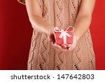 Female Hand Holding Gift Box...