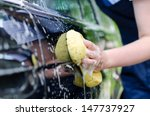 female hand with yellow sponge... | Shutterstock . vector #147737927
