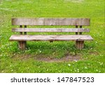 Wooden Park Bench In Nature. A...