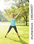 Female Fitness Instructor Doin...