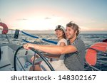 Young Couple Navigating On A...