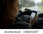 young girl texting and driving  ...   Shutterstock . vector #148351007