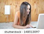 a young woman in her room  with ... | Shutterstock . vector #148513097