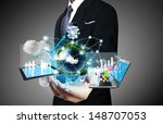 technology in the hands of... | Shutterstock . vector #148707053