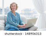 content blonde woman sitting on ... | Shutterstock . vector #148906313