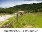Small photo of Mountain village landscape with quickset hedge