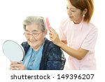 friendly nurse cares for an... | Shutterstock . vector #149396207