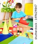 boy cut paper by scissors in... | Shutterstock . vector #149629847